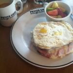Croque madame with fruit and coffee