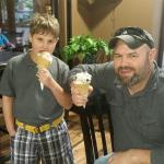 My hubby & one of our sons enjoying their ice cream cones. :)