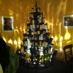 An amazing piece of scenery, combining authentic wine bottles with a tree