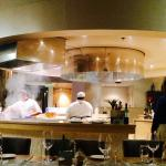 Chefs grilling in the center of the restaurant