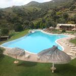 The pool area of Evia Hotel and Suites