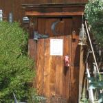 The outhouse. The sign says to knock before entering. That's good advice.