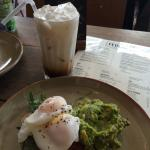 Smashed Avocado with poached eggs and bacon on sourdough toast Delicious!!