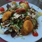 Salad with Walnuts and Toast topped with Baked Goat Cheese