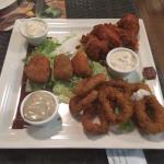 Trio of appetizers. Calamari, chicken wings and jalapeño cheese balls.