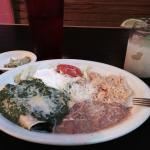 Spinach enchiladas with side of guacamole and frozen margarita
