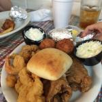 Mate's Plate with shrimp, oysters, small scallops, catfish, hush puppies, baked potato, cole sla