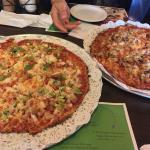"Two ""special"" sized pizzas for four."