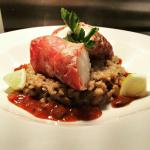 Oven Baked Monkfish, Wrapped in Parma Ham, served on a Wild Mushroom Risotto