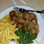 Fantastic tasty meatballs in a funky coloured but yummy gravy with fresh veg and fries followed