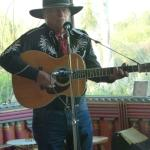 Dick Frederickson performs in the saloon