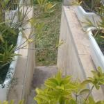 dangerous steps protected by movable plastic plantpots.