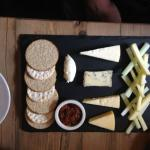 Cheese board with apple and celery
