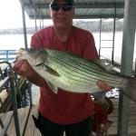Happy guest with a striper