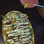 Super nachos and a Margarita