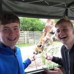 The boys are in awe of their Giraffe Selfie