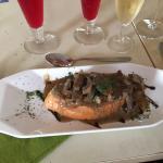 Mushroom Crustini - Medley of mushrooms served in a cream and white wine sauce on an Italian cru