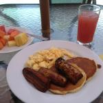 my breakfast: watermelon juice, fresh fruits, eggs, bananas and pancakes