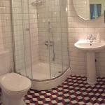 Really clean bathroom (with a blow dryer, heater). Loved those tiles!