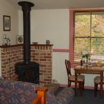 The living area and wood-burning stove (very efficient) at Secrets Maid's quarters.