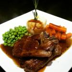 Lamb chops in a minted gravy with mashed potatoes , peas and carrots #bellevuebistro