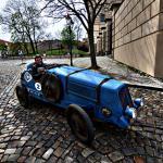 Classic Race car on Cobblestone street near Prague Castle