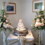 Flowers and cake set up in Function Room