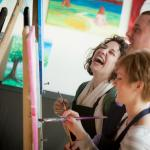 Friends painting together at The Cape Cod Art Bar