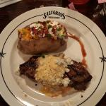 NY strip with bleu cheese butter and baked potato