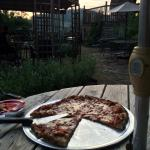 Brick oven pizza out in the garden. Excellent.