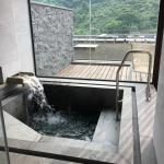 Filling the sunken tub with hot mineral water