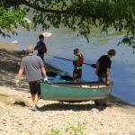 Preparing the kayaks and canoes for the 9-mile trip