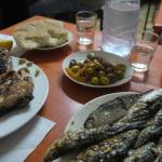 Eating freshly caught and cooked sardines