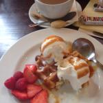 Waffle dessert with fresh red fruits and caramel