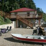 View of the Side of the cabin. To the left is a firepit available to guests