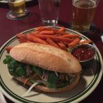 Housemade chicken sausage banh mi with sweet potato fries