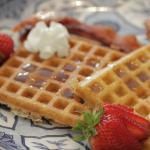 Waffles from scratch with real maple syrup.
