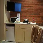 the fridge, tv and coffee making bench