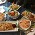 Variety of dishes including Tom Yum Soup, Pad Saew, Pad Ta Kai, Tom Yum Fried Rice