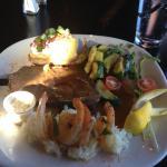 prime rib with rice, shrimp, veggies, and baked potato