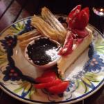 Beautiful cheese cake with churros and chocolate!