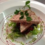 Pork terrine with red wine syrup and dressed mixed leaves