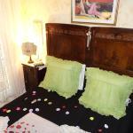 My bed with strewn petals