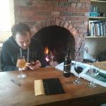 Daniel comfy with beer and fireplace.