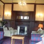 hotel reception area with log fire