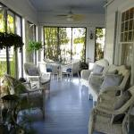 Eat and relax in the screened porch area