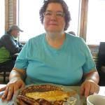 Mom enjoying breakfast.