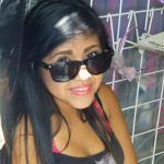 Chica Selling Ropas at Mercado Corona