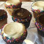Chocolate and Vanilla with buttercream frosting, filled with chocolate pudding, with sprinkles