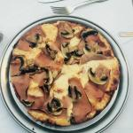 Pizza with mushrooms and hum